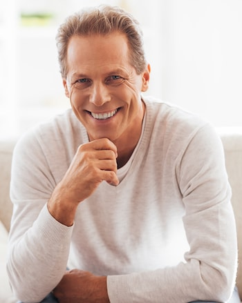 Smiling man who has a bridge using Dental Implants in Shelby Township