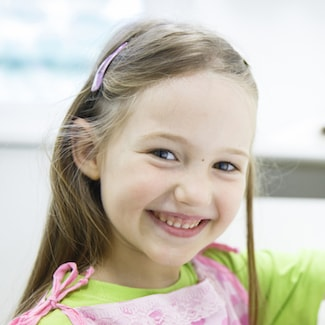 Little girl smiling after her first General Dentistry in Shelby Township experience