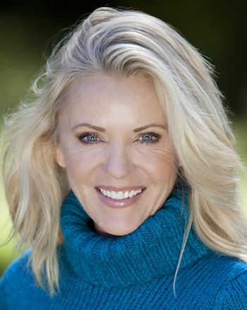 Beautiful woman smiling, she needed bone grafting in order to have Dental Implants in Shelby Township