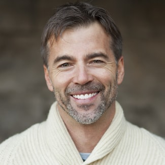 Smiling older man after receiving bonding as part of Shelby Township Cosmetic Dentistry