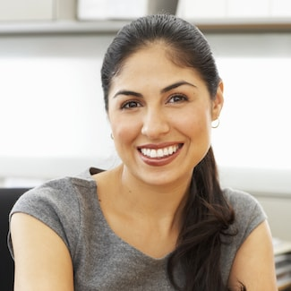 Shelby Township Cosmetic Dentistry caters to women such as this lady smiling